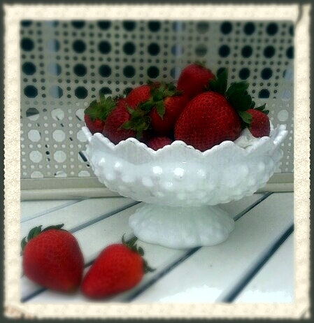 Strawberries in a milk glass bowl just beckon to be eaten.