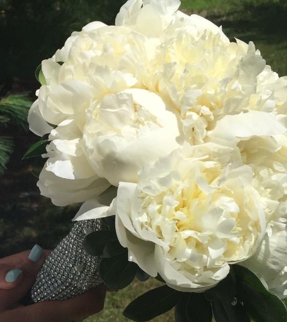 closeup of white peony bouquet